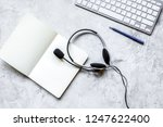 office desk with headset and... | Shutterstock . vector #1247622400