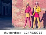 urban fashion. two girl walking ... | Shutterstock . vector #1247630713