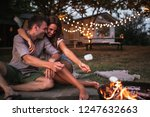 shot of a young couple roasting ...   Shutterstock . vector #1247632663