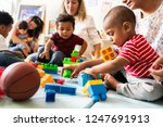 diverse children enjoying... | Shutterstock . vector #1247691913