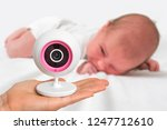 hand of mother is holding baby... | Shutterstock . vector #1247712610