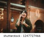 asian woman using smartphone...   Shutterstock . vector #1247727466