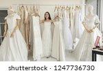 smiling pretty bride chooses... | Shutterstock . vector #1247736730