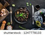 fried mushrooms with parsley on ... | Shutterstock . vector #1247778133