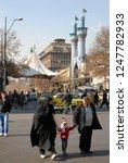 Small photo of Tehran, Iran - January, 2009: Iranian family (father, mother and child). Mundane life of Tehran.