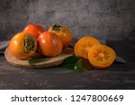 ripe persimmon fruits in a cork ... | Shutterstock . vector #1247800669