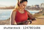 female runner taking a break... | Shutterstock . vector #1247801686