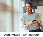cheerful woman entrepreneur... | Shutterstock . vector #1247807086