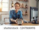 waitress standing at cash... | Shutterstock . vector #1247868496