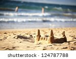 a sandcastle by the ocean  ... | Shutterstock . vector #124787788