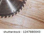 Circular saw on a wood background. Workshop. Manufacture of wooden products. Joiner