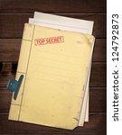 top secret file on wooden table. | Shutterstock . vector #124792873