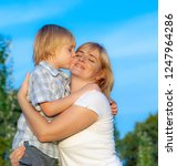 happy mother with son in the... | Shutterstock . vector #1247964286