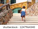 little girl walking up the... | Shutterstock . vector #1247964340