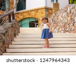 little girl walking up the... | Shutterstock . vector #1247964343