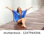 happy woman on the beach | Shutterstock . vector #1247964346