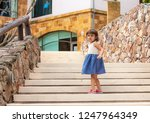 little girl walking up the... | Shutterstock . vector #1247964349