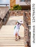 beautiful woman in white hat... | Shutterstock . vector #1247964370