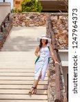 beautiful woman in white hat... | Shutterstock . vector #1247964373