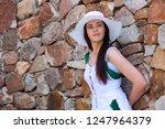 beautiful woman in white hat... | Shutterstock . vector #1247964379