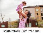 happy mother with a child... | Shutterstock . vector #1247964406