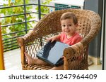 child with a laptop on the... | Shutterstock . vector #1247964409