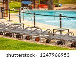 lounge chairs by the pool | Shutterstock . vector #1247966953