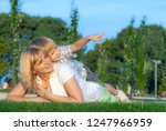 happy mother with son in the... | Shutterstock . vector #1247966959