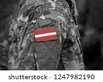 flag of latvia on soldiers arm  ...   Shutterstock . vector #1247982190