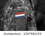 flag of netherlands on soldiers ...   Shutterstock . vector #1247982193