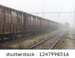 old train wagons parked in the... | Shutterstock . vector #1247998516