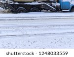 snow covered cars in the winter | Shutterstock . vector #1248033559