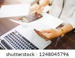 close up on employee woman... | Shutterstock . vector #1248045796