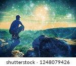 fearless man in sportswear is... | Shutterstock . vector #1248079426