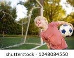 little boy having fun playing a ... | Shutterstock . vector #1248084550