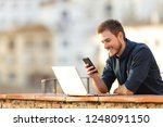 happy man using smart phone and ... | Shutterstock . vector #1248091150