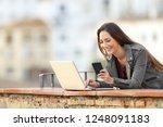 happy woman using smart phone... | Shutterstock . vector #1248091183