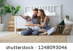 happy family mother  father and ... | Shutterstock . vector #1248093046