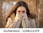 cute young girl at cold winter... | Shutterstock . vector #1248112159