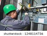 lift machinist adjusting... | Shutterstock . vector #1248114736