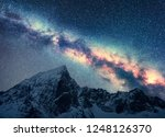 milky way and snowy mountains.... | Shutterstock . vector #1248126370