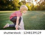 little boy sportsman getting... | Shutterstock . vector #1248139129