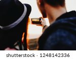 back view of young couple using ... | Shutterstock . vector #1248142336