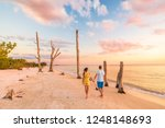 couple walking on beach at... | Shutterstock . vector #1248148693