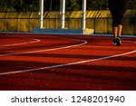 red running track with runner's ... | Shutterstock . vector #1248201940