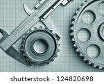 gears and caliper on graph paper | Shutterstock . vector #124820698