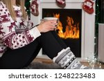 girl holding cup of tea on legs ... | Shutterstock . vector #1248223483