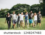 happy diverse people enjoying... | Shutterstock . vector #1248247483