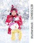 girl makes a snowman outside in ... | Shutterstock . vector #124832128