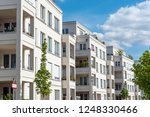row of white modern apartment... | Shutterstock . vector #1248330466
